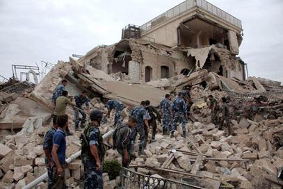Рашчишћавање рушевина после недацне терористичке акције