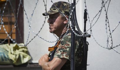 Иза жице - мир? / © Photo: REUTERS/Shamil Zhumatov