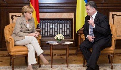 Порошенко и Меркел о распуштању парламента и преговорима у Минску / © Фото: РИА Новости/Микхаил Маркив